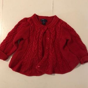 Red button up cable knit sweater